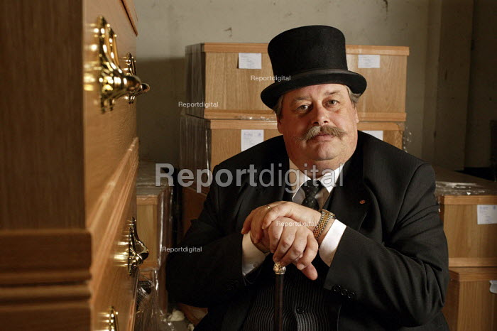 A funeral undertaker sitting in a room of empty coffins. - David Mansell - 2007-05-21