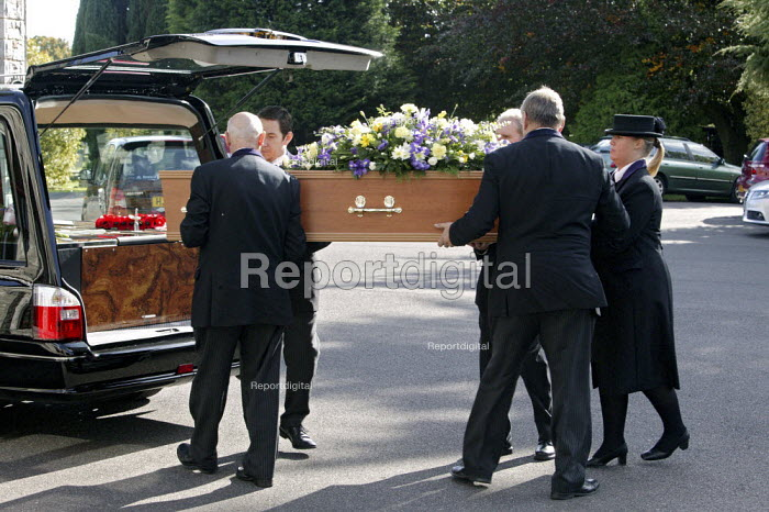 Funeral undertakers carrying a coffin into the chapel of rest at a funeral service, at the local authority crematorium in Bournemouth. - David Mansell - 2008-10-09