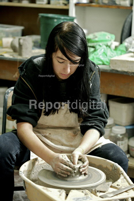 A art student making ceramics on a potter's wheel during a weekend pottery course at the Lewisham Old Library, London. - David Mansell - 2007-09-07