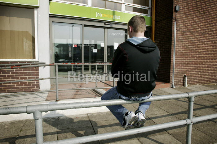 An unemployed young man who has just been released from prison sitting on the top of the railings outside the Job Centre Plus building in Chesterfield, Derbyshire. - David Mansell - 2010-03-20