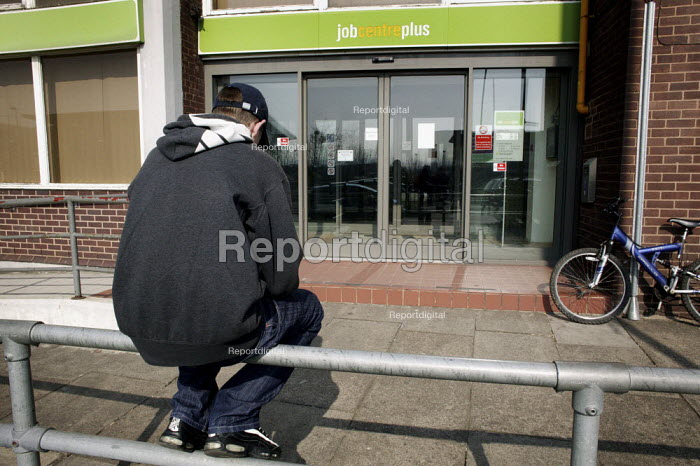 An unemployed young man waiting for an interview outside the Job Centre Plus building in Chesterfield, Derbyshire. - David Mansell - 2010-03-20