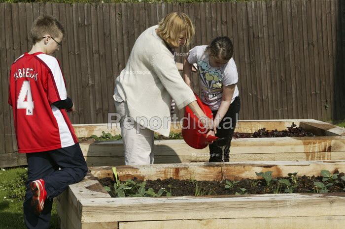 Watering the garden. A children's home in Essex a small home of six to seven children, with as many adults caring for them, using the principle of social pedagogy used to guide, mentor and teach children in care. - David Mansell - 2009-04-19