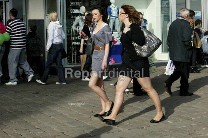 Young women strolling through the pedestrian shopping centre, in the town centre of Chesterfield, Derbyshire. - David Mansell - 2009-03-14
