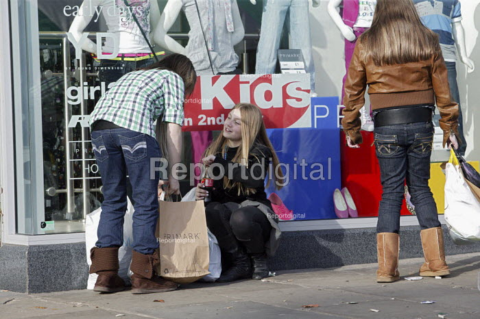 Young girl shoppers with their bags of new clothes after visiting a Primark shop, in the town centre of Chesterfield, Derbyshire. - David Mansell - 2009-03-14