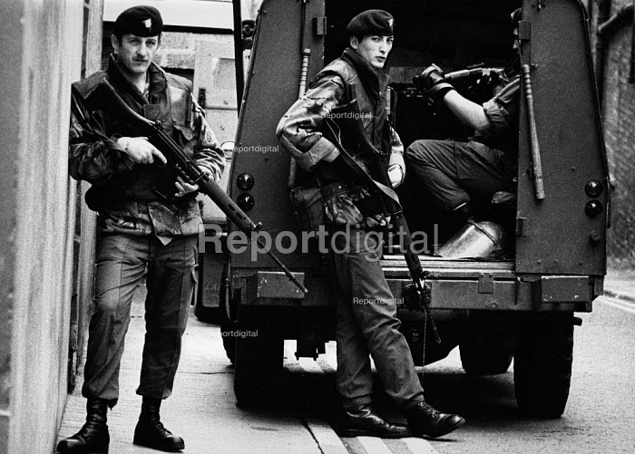 British soldiers patrolling in the protestant area of the west bank, The Fountain, Derry, Northern Ireland 1978, as Unionists celebrate the Apprentice Boys parade on 12 August to commemorate the Protestant victory over the Catholics in the Siege of Derry in 1689 - David Mansell - 1978-08-12