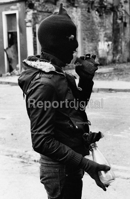 Rioting, The Bogside, Derry, Northern Ireland 1981 after the death of IRA prisoner Bobby Sands on hunger strike. The IRA prisoner Bobby Sands started his hunger strike on 1st March and died 66 days later on the 5 May 1981. There were a total of ten hunger strikers who died in 1981, as it was a showdown between republican prisoners who wanted political status as prisoners and the refusal of the British. Their deaths resulted in rioting in nationalist areas of Northern Ireland in particular The Bogside in Derry, as seen by this hooded masked youth armed with a stone in one hand and a molotov cocktail, a petrol bomb in the other hand. - David Mansell - 1981-04-06
