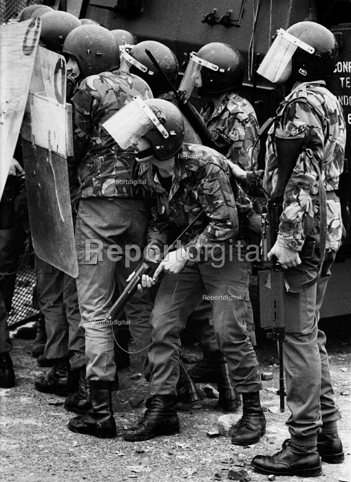Rioting, The Bogside, Derry, Northern Ireland 1979 A soldier with a Swastika scratched on the side of his helmet- strongly associated with fascism and nazism. Rioting started in the Bogside of Derry after the unionists had celebrated the Apprentice Boys parade after which large groups of nationalist youths pelting the army with stones and molotov cocktails - David Mansell - 1979-08-04
