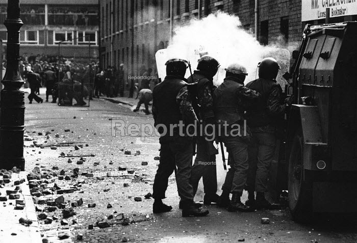 Rioting, The Bogside, Derry, Northern Ireland 1981 after the death of IRA prisoner Bobby Sands on hunger strike. The IRA prisoner Bobby Sands started his hunger strike on 1st March and died 66 days later on the 5 May 1981. There were a total of ten hunger strikers who died in 1981, as it was a showdown between republican prisoners who wanted political status as prisoners and the refusal by the British. Their deaths resulted in serious rioting in the nationalist areas of Northern Ireland in particular the Bogside in Derry, as experienced by these British soldiers shielding themselves behind their riot shields and their Pig armoured vehicle as they come under attack from rioters throwing stones and petrol bombs. - David Mansell - 1981-04-06