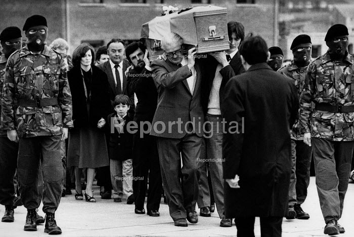 Funeral of the IRA prisoner Bobby Sands, 1981 his coffin is carried by his father and brother at the front, with Owen Carron who preceded Sands as MP for Fermanagh and South Tyrone, followed by Sands wife Geraldine Hoade and their 8 yrs old son Gerard, flanked by six uniformed and masked IRA volunteers. Sands, started his hunger strike on 1st March and died 66 days later on the 5 May 1981. There were a total of ten hunger strikers who died in 1981. - David Mansell - 1981-05-09