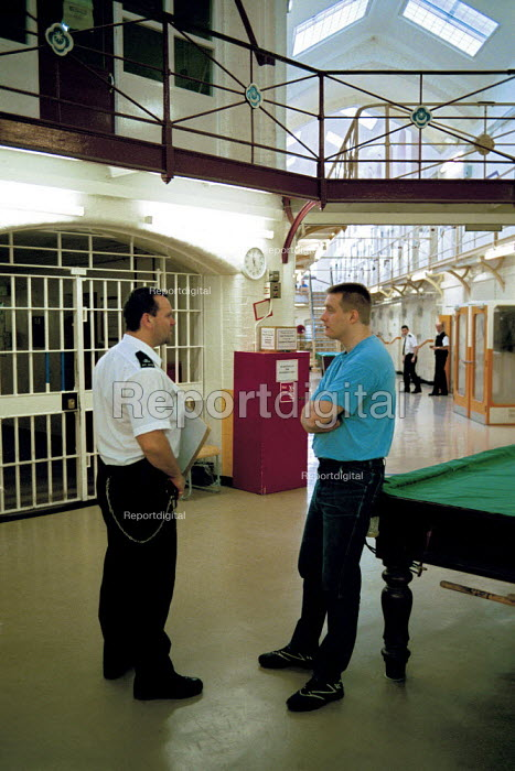 A day in the life of the inmates and staff of Kingston Prison, Portsmouth. A prison officer talks to an inmate who is serving life for murder. - David Mansell - 2001-01-16