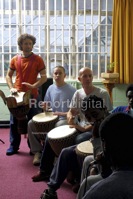 A drumming workshop at Aylesbury Young Offenders intitution organised by Live Music Now and the Jerwood Foundation. - David Mansell - 2002-11-01