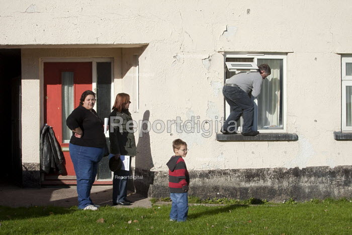 A family who have accidentally got locked out of their council house manage to open the window and let themselves back in their home on the Twyncarmel Estate in Merthyr Tydfil. Merthyr Tydfil has very high levels of unemployment - David Mansell - 2010-11-10