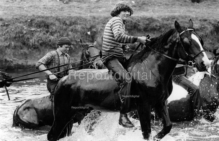 The Appleby Horse Fair, 1978 Riding the horses through the River Eden. Around ten thousand English and Welsh Gypsies, Scottish Gypsy, Travellers and Irish Travellers have converged each year to buy and sell horses. The fair is one of the oldest horse fairs in Britain. The Appleby Horse Fair, Appleby-in Westmorland, Cumbria, a charter fair. - David Mansell - 1978-06-08