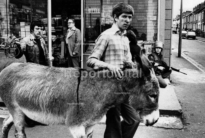 Catholics with a donkey as a partoling Bstidh Army soldier looks on, Falls Road West Belfast - David Mansell - 1978-08-12