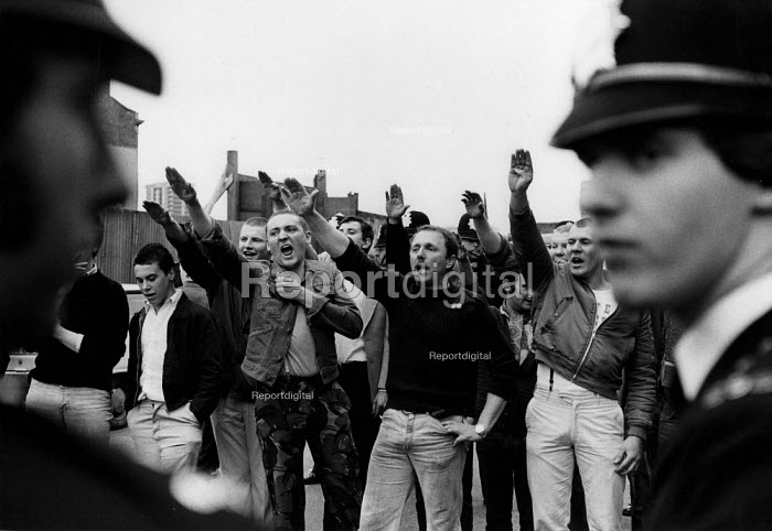 National Front giving fascist salutes as an anti racist march passes by, Lewisham, London 1977 Police watching Far right group, The Battle of Lewisham - David Mansell - 1977-07-13