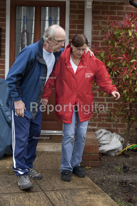 Malcolm and Ruth Parker leaving their home in Fleet, Hampshire. Malcolm who at 63 yrs is to have his disability payments reduced by government cut backs due to the fact his wife Ruth works more than 24 hours a week. Malcolm who started work at 15 yrs worked for most of his life as a construction worker which has lead to him to become disabled with severe pain and a with back injury, he is unable to walk by himself. - David Mansell - 2013-04-28