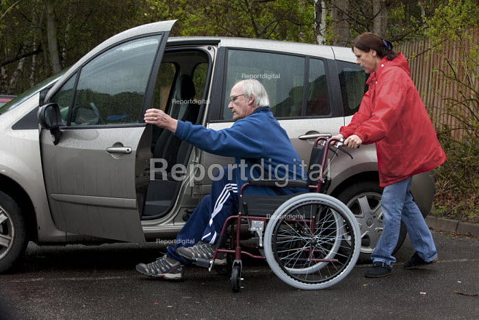 Getting into the car. Malcolm and Ruth Parker leaving their home in Fleet, Hampshire. Malcolm who at 63 yrs is to have his disability payments reduced by government cut backs due to the fact his wife Ruth works more than 24 hours a week. Malcolm who started work at 15 yrs worked for most of his life as a construction worker which has lead to him to become disabled with severe pain and a with back injury, he is unable to walk by himself. - David Mansell - 2013-04-28