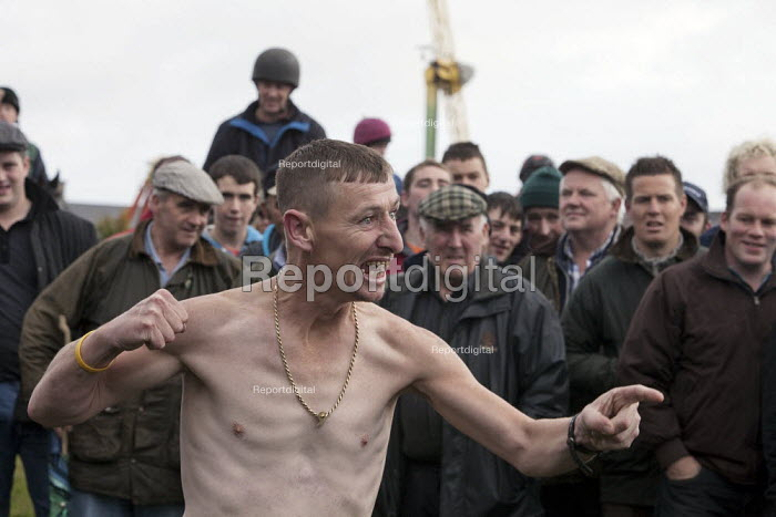 Country Fair Day, The Ballinasloe Horse Fair, County Galway, Ireland. Young man who has too much to drink causing trouble by trying to fight someone with whom he had a disagreement - David Mansell - 2012-04-29