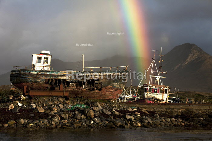 Derelict fishing boats, Derryinver Pier, Letterfrack, Connemara, County Galway. And rainbow. EU Common Fisheries Policy has led to the contraction of the Irish fishing industry - David Mansell - 2012-10-05
