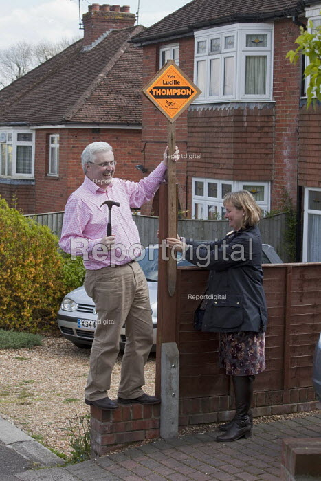 Liberal Democrat candidate Lucille Thompson and her councillor husband Andrew Thompson putting up election posters in the Hampshire town of Winchester, where the Liberal Democrats hold controlling power with the Conservatives. - David Mansell - 2012-04-23