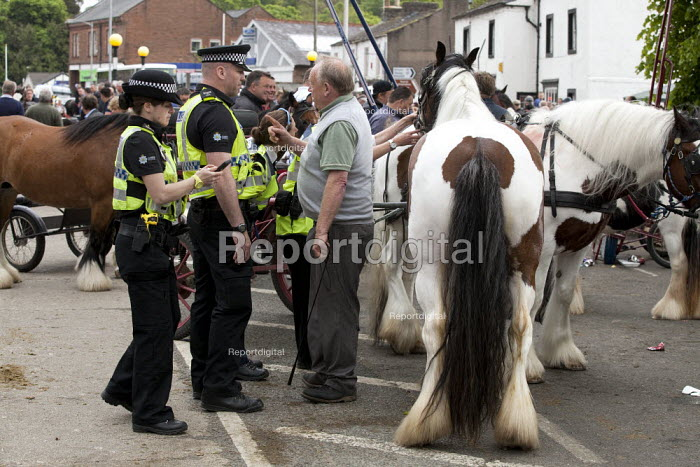 Appleby Horse Fair, Cumbria, Police warning Tom Harker a horse dealer to slow down when showing horses. - David Mansell - 2015-06-05