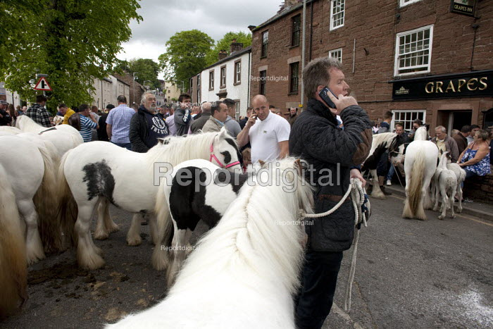Appleby Horse Fair, Cumbria, Horse dealer talking on his mobile phone - David Mansell - 2015-06-05