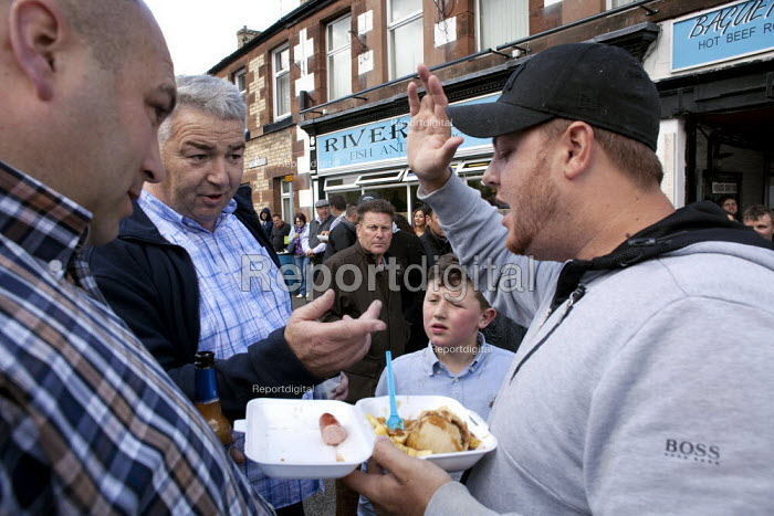 Appleby Horse Fair, Cumbria, buying and selling a horse over a lunchtime takeaway, Lee Smith doing a deal with a technique known as the slap of the hand - David Mansell - 2015-06-06