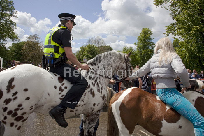 Appleby Horse Fair, Cumbria, Police officer riding a horse bareback supervised by the owner, joining in the spirit of the horse fair - David Mansell - 2015-06-07