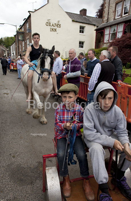 Appleby Horse Fair, Cumbria, youth showing horses to dealers and buyers along the Sands - David Mansell - 2015-06-07