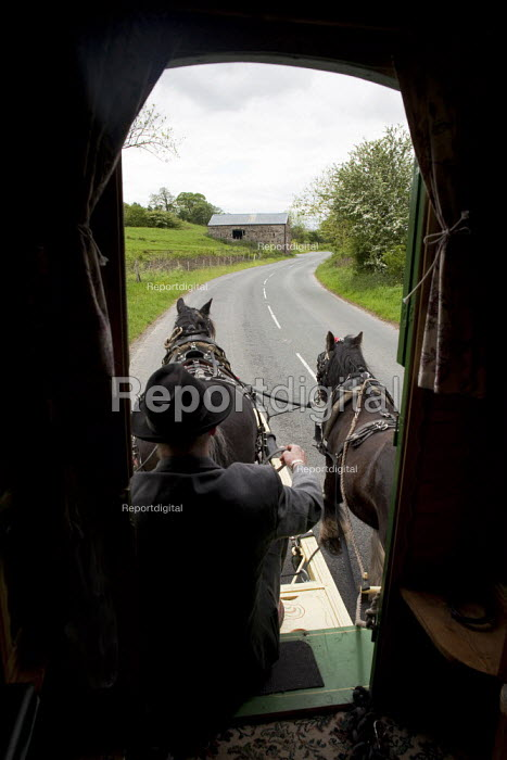 Appleby Horse Fair, Cumbria, Farmer Frank Throup in a horse drawn caravan returning home using the spectacular scenic open moorland route from Kirkby Stephen to Sedbergh. - David Mansell - 2015-06-09
