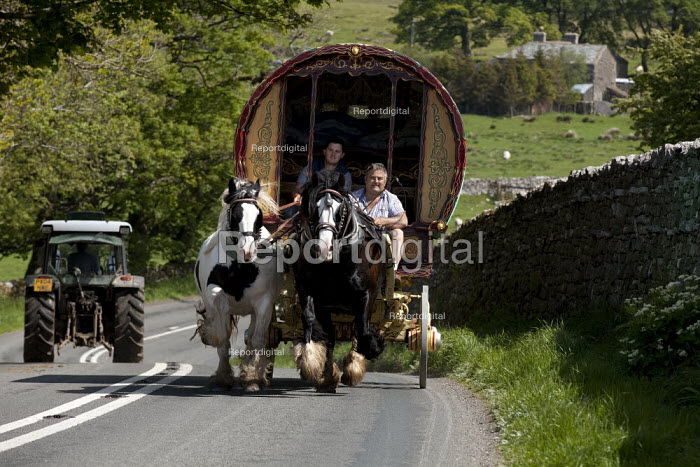 Appleby Horse Fair, Cumbria, Horse drawn caravan returning home along the scenic open moorland route from Kirkby Stephen to Sedbergh. Terry Carney and his son Albert from Blackpool, are using this favourite and well used route - David Mansell - 2015-06-08