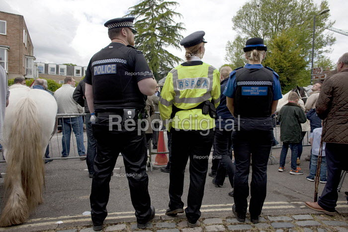Wickham Horse Fair, Hampshire. RSPCA inspector working with Police officers watching horse dealers showing off their horses - David Mansell - 2015-05-20
