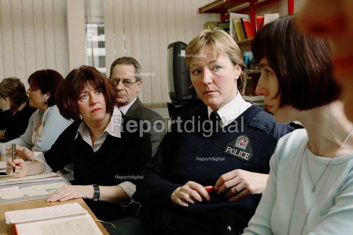 The Leigh Park Family School Support Team (Fasst) is based in Havant, Hampshire, a vitual multi agency team set up to support pupils, families and teachers within the area. The team meet once a week and is made up of social workers, school nurses, police, mental health workers, psychotherapist, and teachers. pictures show Penny Courser the founder and team leader at the beginning of a meeting - David Mansell - 2005-02-01