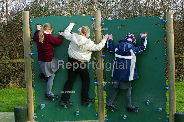 Wedmore First School, a 210 pupil village school in Wedmore, Somerset, run by Somerset LEA. Girls are seen on the climbing wall of the activity trail funded by the PTA during their lunch break.play time exercise climbing keeping fit - David Mansell - 2005-02-08
