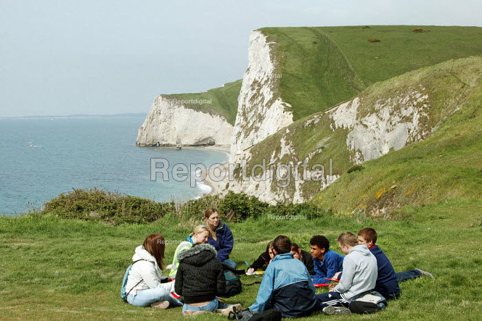 School pupils studying GCSE geography on a weekend field course at the World Heritage Site, known as Jurassic Coast, on th Cliffs and coast line of Durdle Door, Dorset. - David Mansell - 2005-05-15