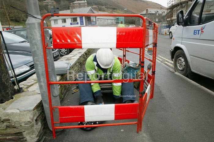 Boscastle, Cornwall. Five hours of heavy rain on the afternoon of 16 August 2004 caused devastating flood and storm damage. Local BT engineer Steve Osteen from Camelford, worked for six weeks on replacing all the damaged telephone cables destroyed by flood damage. - David Mansell - 2005-03-08