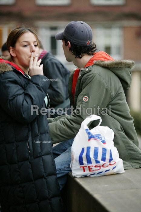 Birmingham University - student undergraduates on campus. Woman student smoking. - David Mansell - 2005-03-15