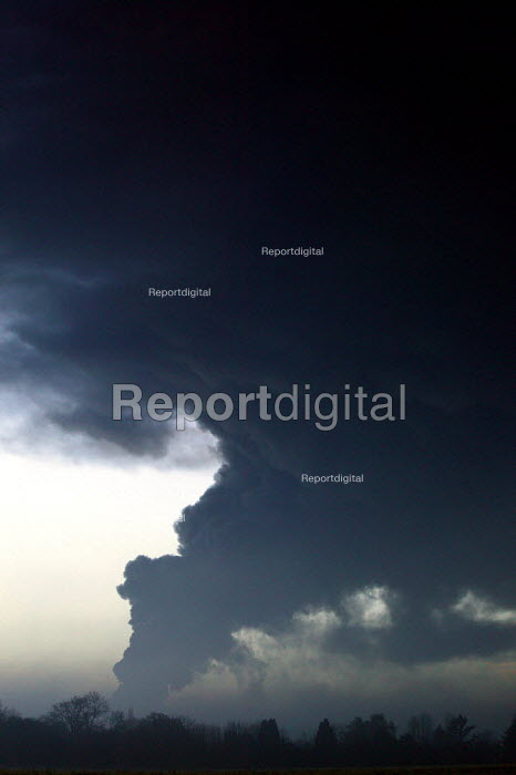 A plume of black smoke filling the sky as the Buncefield oil depot burns. Hemel Hempstead - David Mansell - 2005-12-11