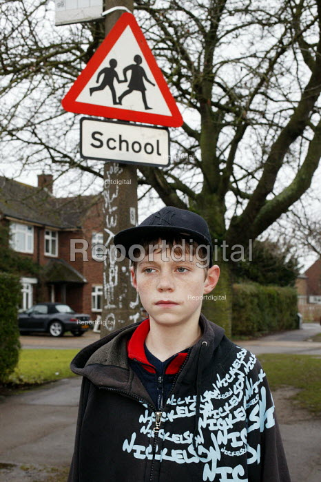 Peter Palmer, 14 years old, who he has been excluded from main school education, is seen outside the North Herts Education Support Centre in Letchworth, Hertfordshire. - David Mansell - 2006-02-13