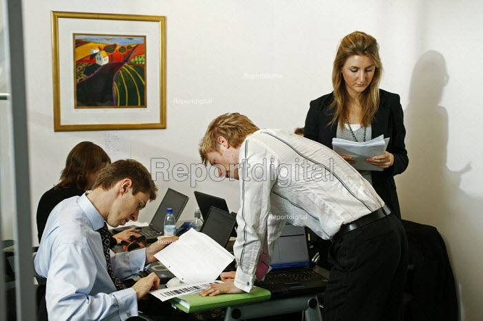 Auditors from Deloitte carrying out an audit in the offices at CB Richard Ellis, the world's largest property estate agents based in the square mile of the City of London. - David Mansell - 2006-01-09