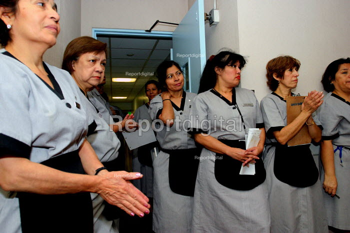 Housekeepers at the Beverly Hilton Hotel, one of the most luxurious in the US, belong to Local 11 of UNITE HERE, the national union for hotel workers, at a union meeting. - David Bacon - 2006-11-24