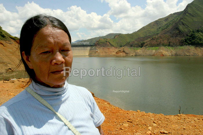 This indigenous woman and her family were uprooted when the dam, reservoir and hydroelectric project on the Rio Salvajina was built in 1984. Thousands of the indigenous population were displaced and forced to leave the vally and the environment scarred and degraded.. The dam and hydroelectric station is operated by the Spanish company, Union Fenosa, which exports the electricity generated to other countries in South America. Colombia - David Bacon - 2006-10-25