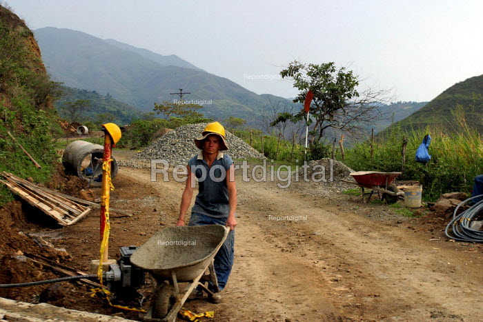 A worker in a crew repairing the road to Toribio. Colombia - David Bacon, dnb0612jh14.jpg