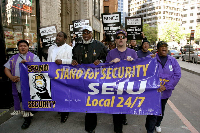 Security guards in San Francisco march to pressure security companies and empolers into improving wages and conditions for guards, and signing a new union contract with Service Employees International Union Local 24/7. They were joined by delegates from security guard unions in New York, Los Angeles and other cities, who are coordinating bargaining and action with their common employers, multinational property management companies and building owners. - David Bacon - 2007-06-28