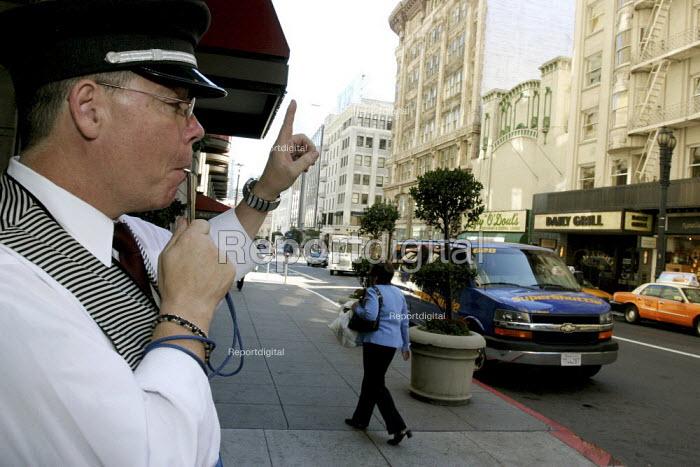 A doorman at the St. Francis Hotel, calling a taxi. - David Bacon - 2007-10-08