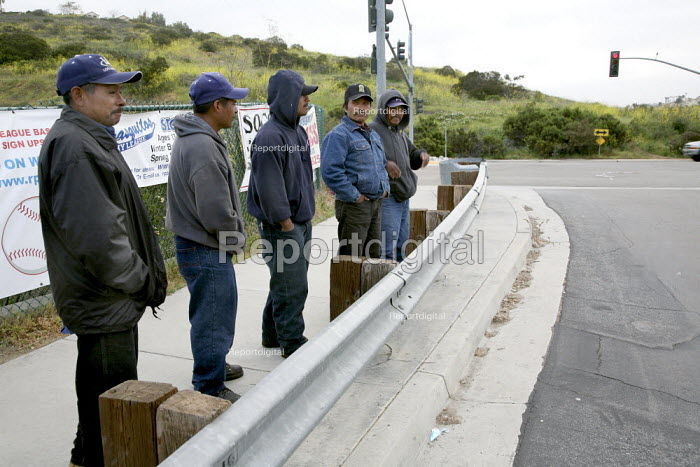 San Diego, California, Mixtec men from Oaxaca waiting by the roadside for work early in the morning. They live in the Los Peasquitos canyon on the north edge of San Diego and work as day laborers and farm workers - David Bacon - 2008-04-01