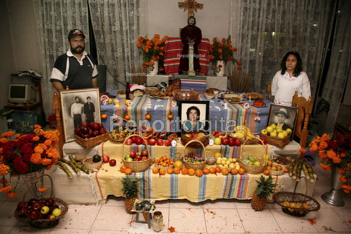 Artist Alejandro Vera and his wife in front of a altar they have made for Day of the Dead. - David Bacon - 2008-11-04