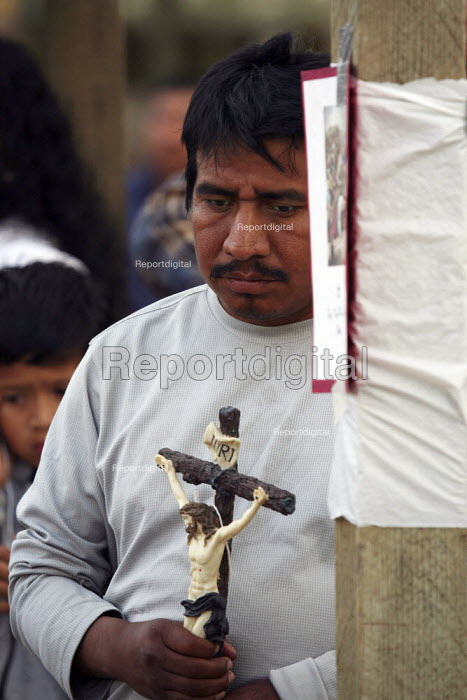 Mixtec migrants from Oaxaca, celebrating Good Friday. The community walks from one to another of the Stations of the Cross, as part of a Catholic ritual that remembers the crucifixion of Christ. A devotion commemorating the Passion. Caruthers, California. - David Bacon - 2009-04-10