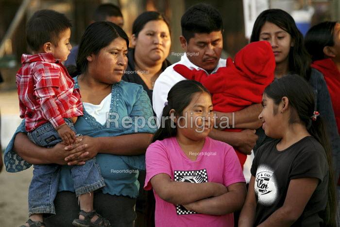 A family of Indigenous Mixtec migrants from Oaxaca, celebrating Good Friday. - David Bacon - 2009-04-10