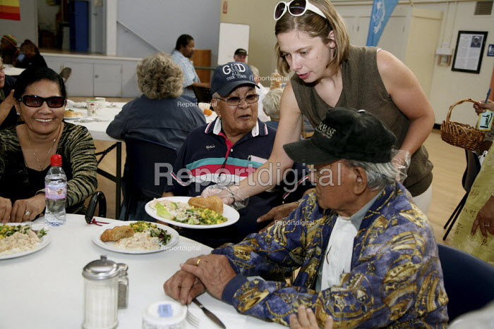 A volunteer serves food to seniors at St. Mary's. Poor... - David Bacon, DNB0908hh13.jpg